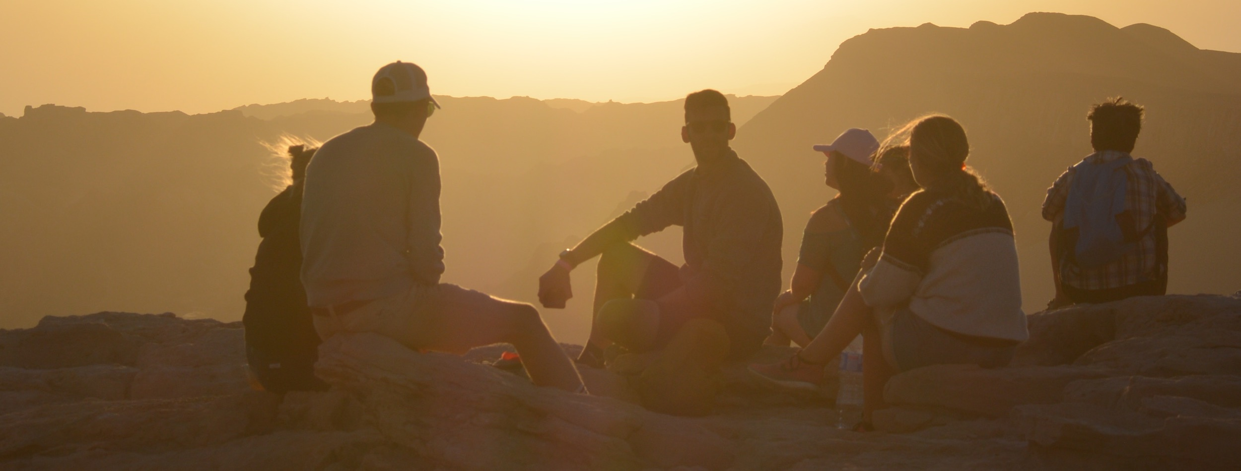 Group of people at sunset